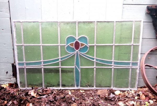 Antique stained glass window blue bow long scaled